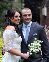 Happy newly-weds portrait wedding photograph captured by Surrey Lane wedding photography outside Sutton Register Office