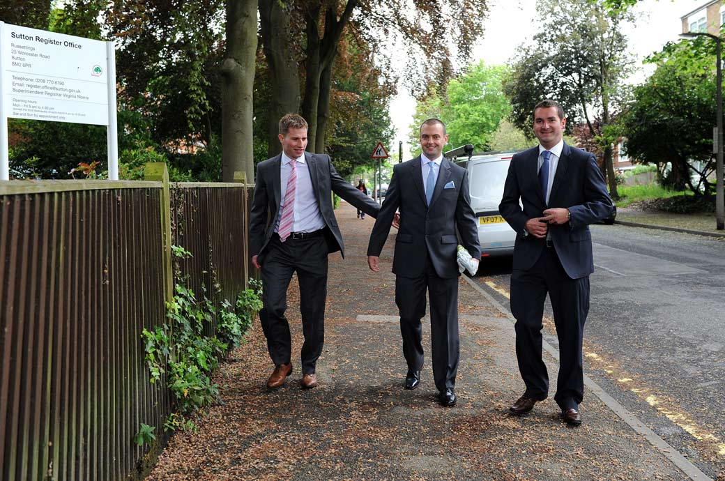 The Groom and his best men in this informal wedding photograph taken as they approach the Surrey wedding venue Sutton Register Office for the Big Day