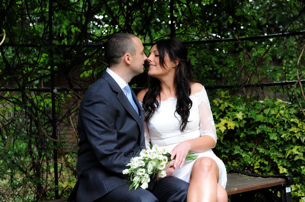 Intimate nose to nose moment captured in this romantic wedding picture by Surrey Lane wedding photography in the garden at Sutton Register Office