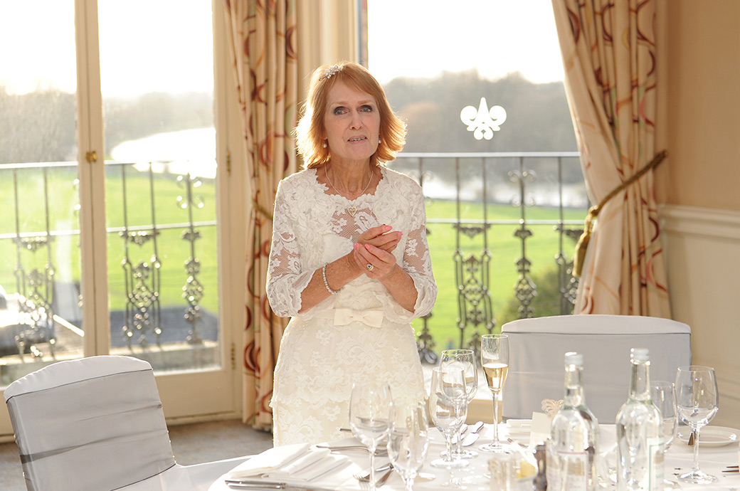 Lovely radiant Bride at The Petersham Hotel in Richmond Surrey inspecting the wedding breakfast settings in the River Room with its fabulous views over The Thames