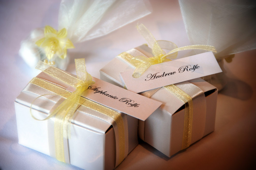 A picture of some delicate looking favour boxes personalised with the Bride and Groom's names taken in the Terrace Room at The Petersham, Richmond