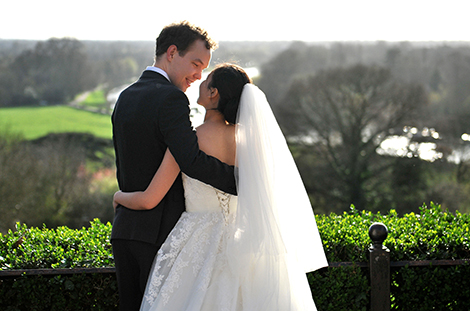 Young lovers share a romantic moment together on the famous Terrace Walk on Richmond Hill after their wedding at Surrey wedding venue The Petersham
