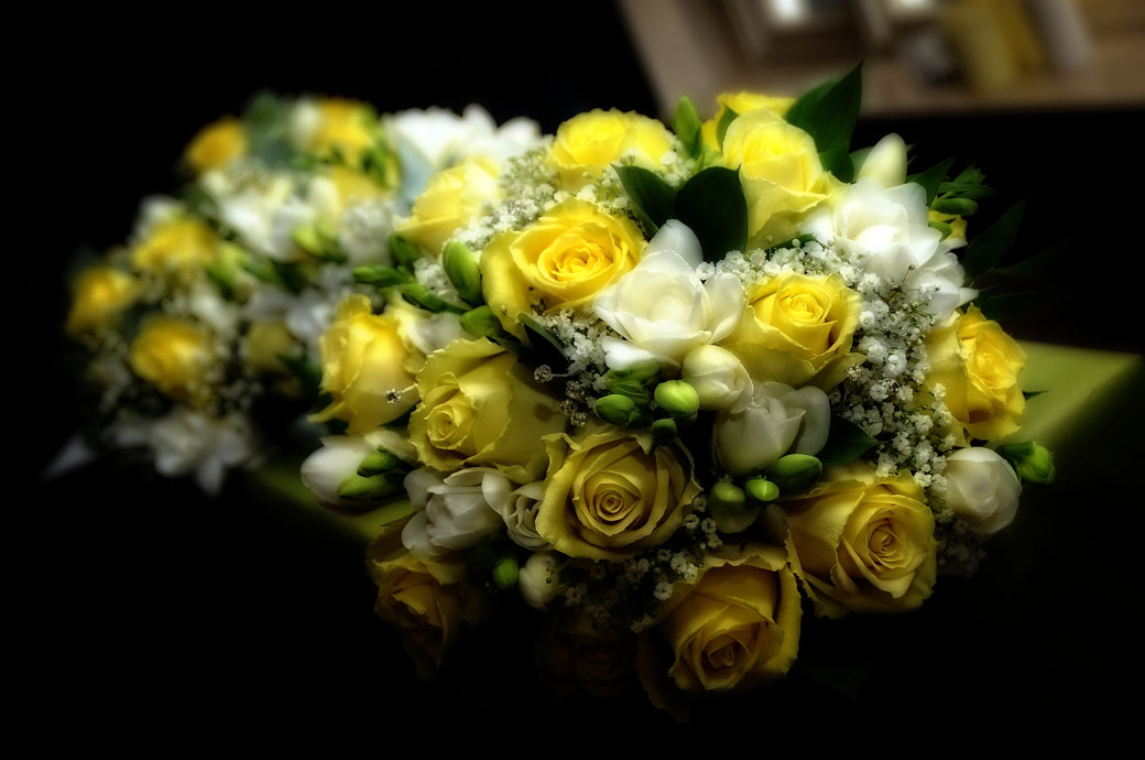 A beautiful white and yellow rose bouquet wedding picture taken at the historic coaching inn Surrey wedding venue, The Talbot in picturesque Ripley