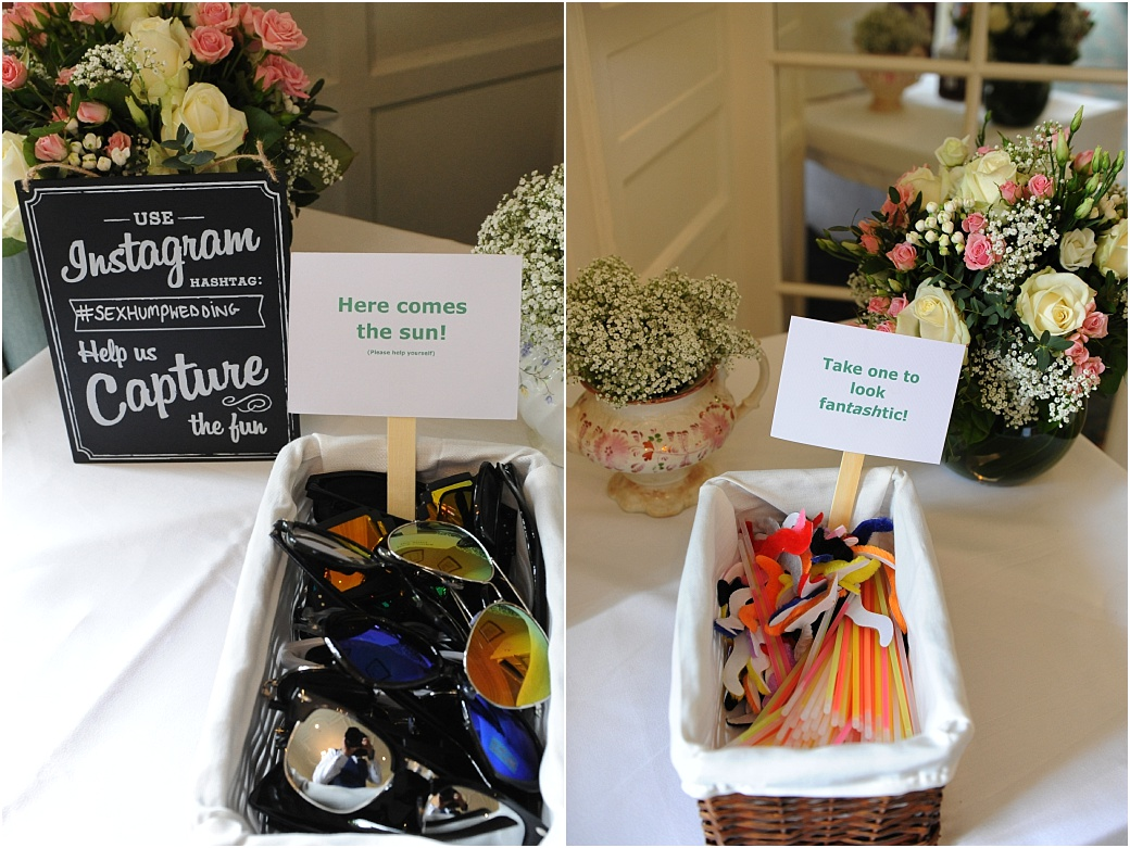 Wedding photograph from Surrey wedding venue Warren House in Kingston of fun and colourful fancy dress Sunglasses and moustache accessories
