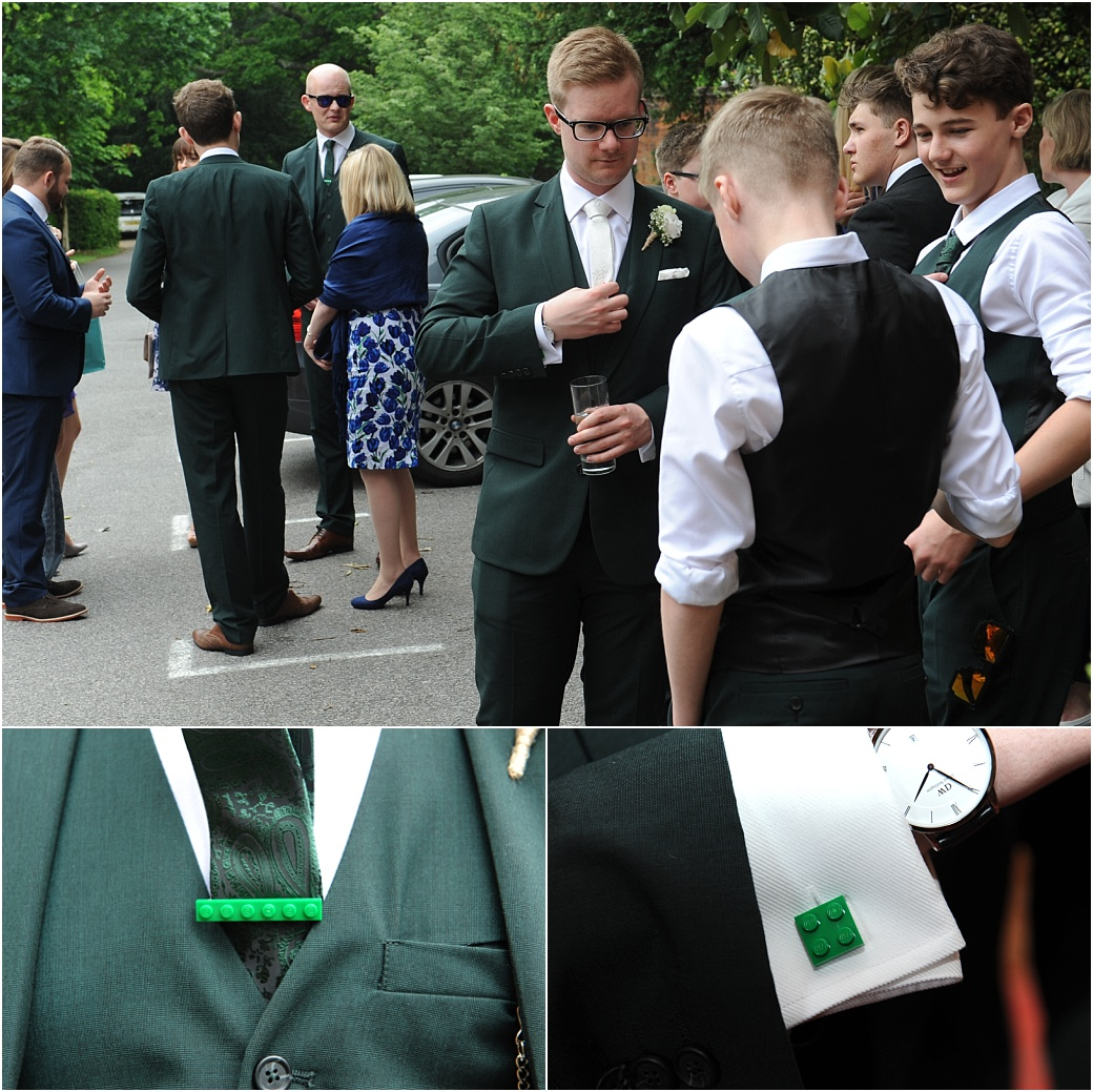 A smart looking Groom with his distinct wedding attire comprising green suite and Lego tie pin and Lego cufflinks captured at the green and grand Surrey wedding venue Warren House