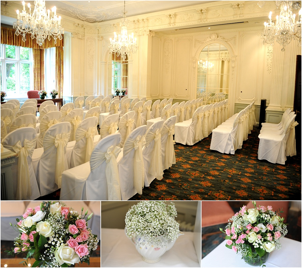 Flowers and chairs ready for the wedding ceremony set up at the grand Surrey wedding venue Warren House in Kingston in the opulent Edwardian Ballroom