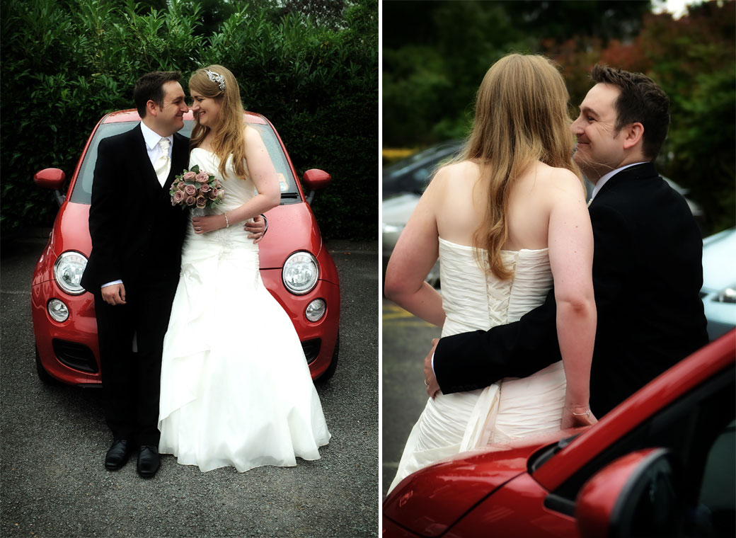 Happy newlywed couple have a little cuddle by their red car captured in these wedding photographs taken at Weybridge Register Office by a Surrey Lane wedding photographer
