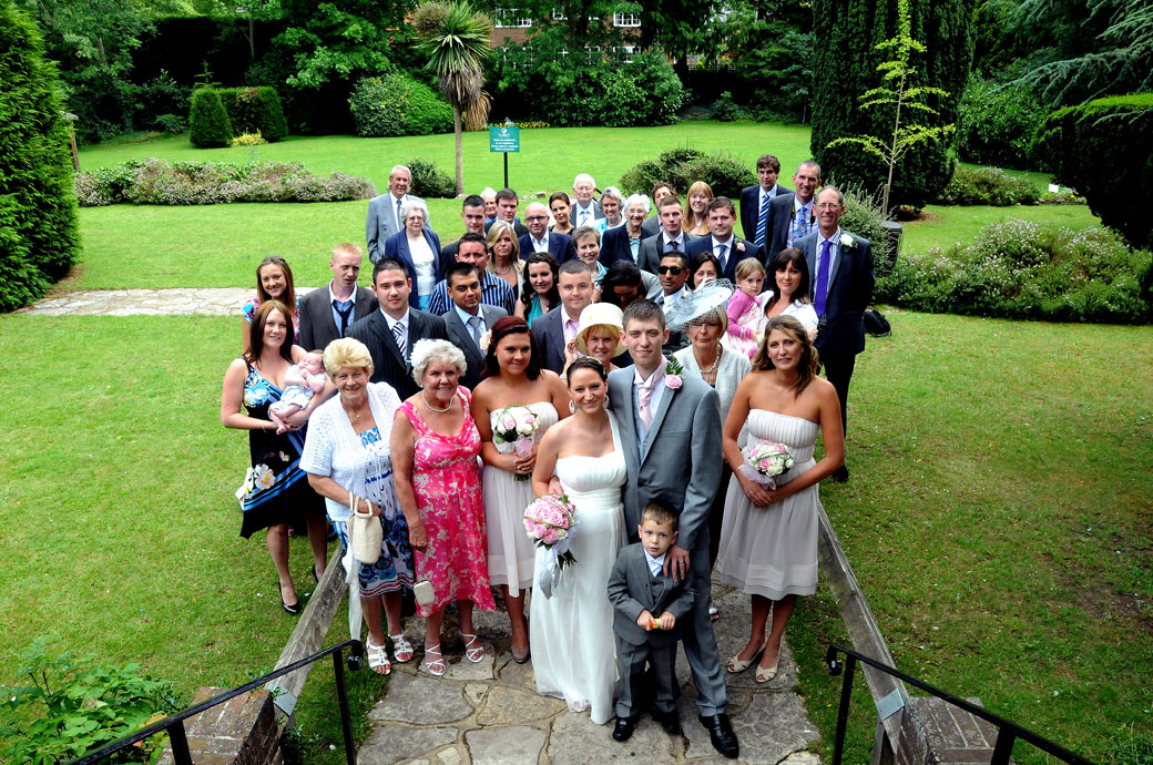 Everyone at the wedding photograph taken looking down from the top of the steps of the garden at Weybridge Register Office Surrey