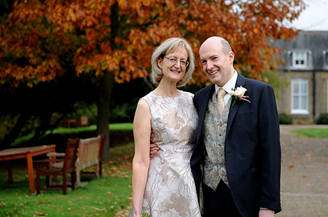 Wedding photograph of a happy newlywed couple having a walk at Oatlands Park Hotel after their marriage at popular nearby wedding venue Weybridge Register Office in Surrey