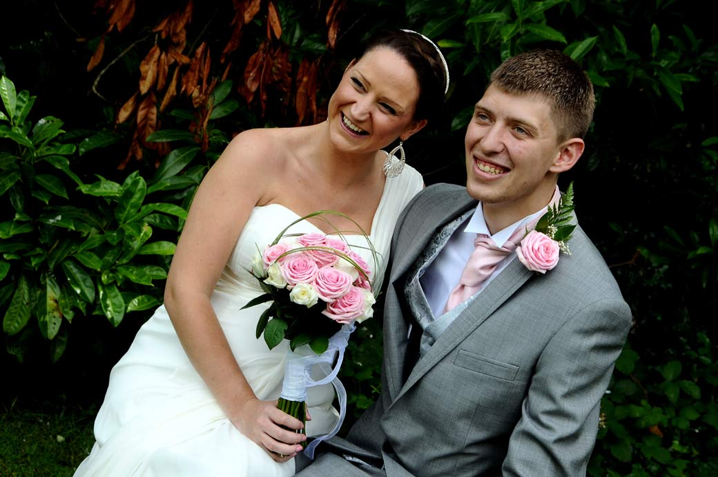 A relaxed and happy wedding couple wedding photograph in the garden at Weybridge Register Office by a Surrey Lane wedding photographer