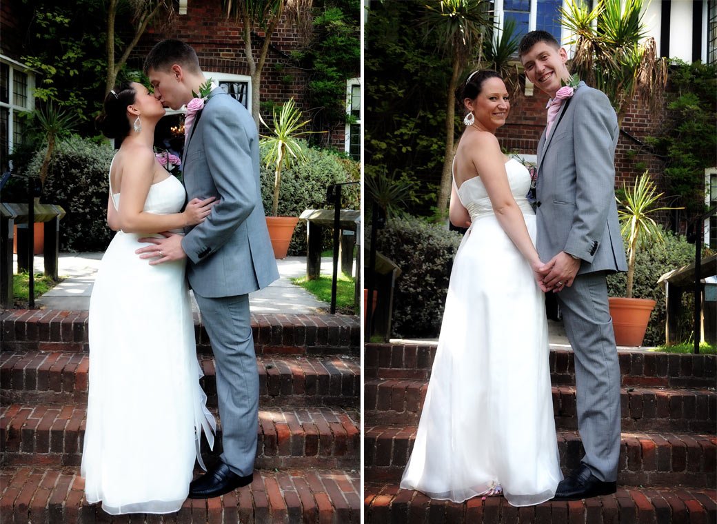 Newly-weds standing holding hands and kissing in these two wedding photos taken in the Weybridge Register Office garden by Surrey Lane wedding photography