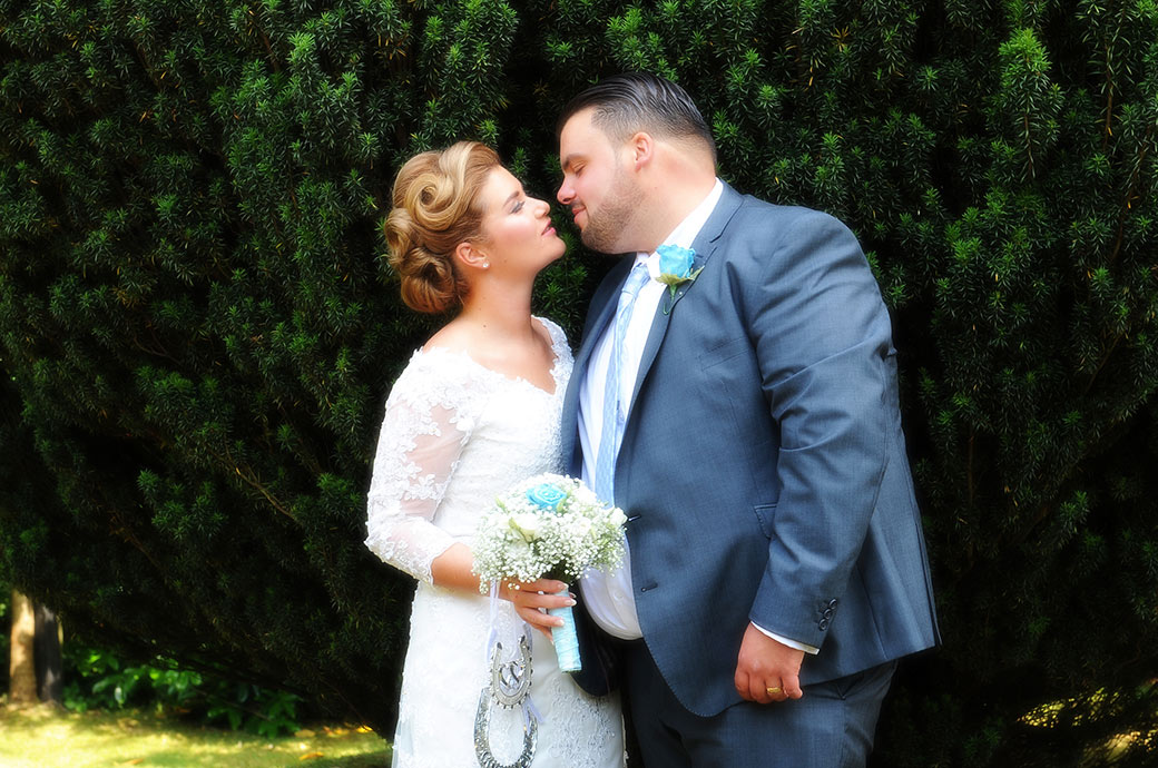 Bride  and groom captured in this wedding photograph taken at Surrey wedding venue Weybridge Register Office just as they are about to kiss