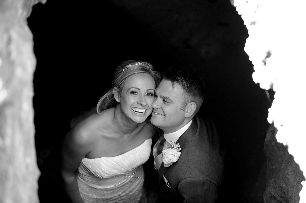 Love and fun captured in this wedding picture taken of the newlyweds by a Surrey Lane wedding photographer from the top of a Wotton House grotto looking down