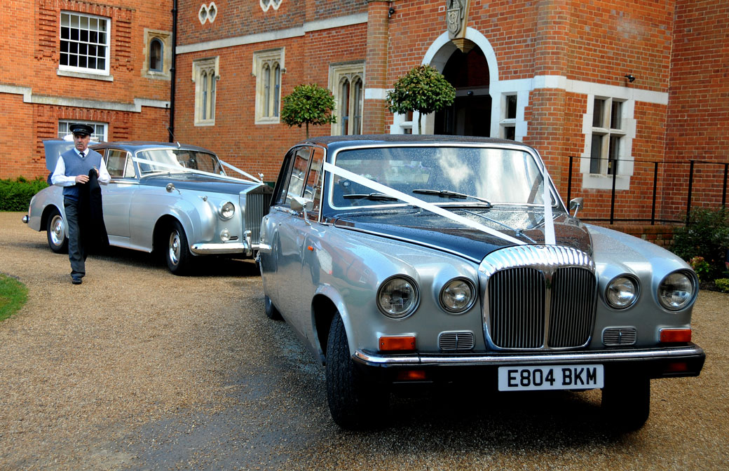 Classic silver Rolls Royce and Daimler bridal cars in this wedding picture taken at the lovely Surrey wedding venue Wotton House Dorking