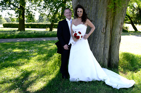 Beautiful beaming couple captured in this wedding photograph by Surrey Lane wedding photography at Merton Register Office Morden Park House