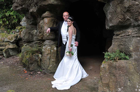 Lovely wedding photo of the content couple standing by the historic and listed grotto at Surrey wedding venue Wotton House