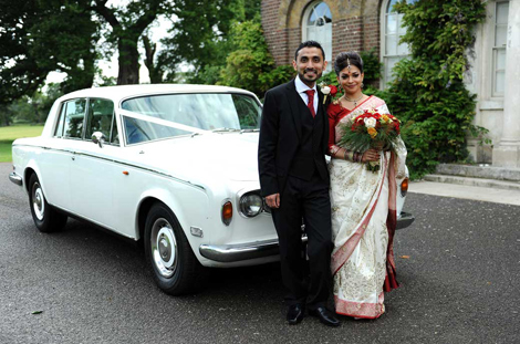 Standing in front of their Rolls Royce Bridal car wedding photograph taken in front of Morden Park House at Merton Register Office