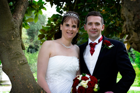Relaxed wedding couple wedding photograph taken amongst the trees captured by Surrey Lane wedding photographers at  Holiday Inn Sutton