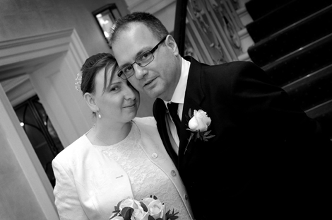 Sweet wedding picture of couple with heads together taken on the staircase at Surrey wedding venue Merton Register Office Morden Park House