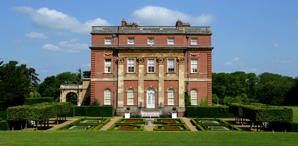 Grand facade to the stunning Clandon Park Surrey a truly magnificent wedding venue offering wonderfully memorable wedding photography opportunities