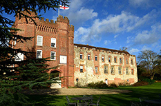 A wedding photograph of the majestic Bishop's Palace on a December day at the historic Farnham Castle a fabulous Surrey wedding venue overlooking the town of Farnham