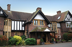A photograph of the popular and very welcoming Surrey wedding venue Weybridge Register Office situated in a suburban road with a large garden area
